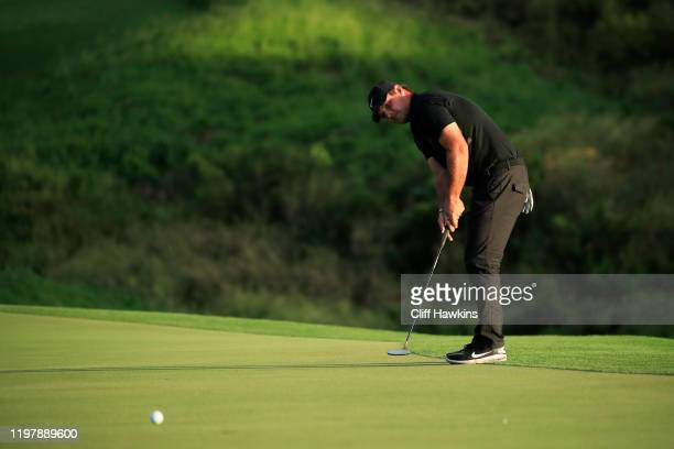 Patrick Reed of the United States putts on the 18th green during a playoff in the final round of the Sentry Tournament Of Champions at the Kapalua...