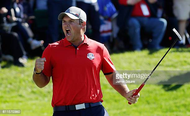 Patrick Reed of the United States reacts after making a putt on the 16th green to end the match during morning foursome matches of the 2016 Ryder Cup...