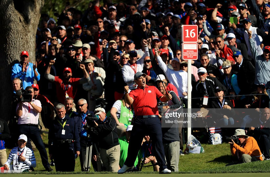 Patrick Reed of the United States reacts after making a putt on the 16th green to end the match during morning foursome matches of the 2016 Ryder Cup at Hazeltine National Golf Club on September 30, 2016 in Chaska, Minnesota.