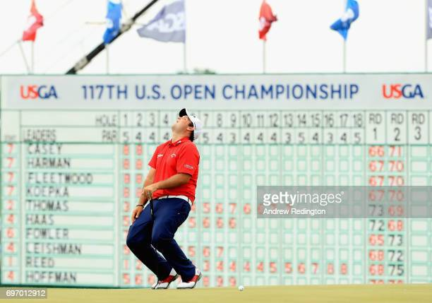 Patrick Reed of the United States reacts after missing a putt on the 18th green during the third round of the 2017 US Open at Erin Hills on June 17...