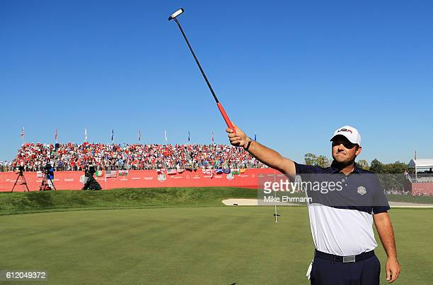 Patrick Reed of the United States reacts on the 18th green after winning his match during singles matches of the 2016 Ryder Cup at Hazeltine National...