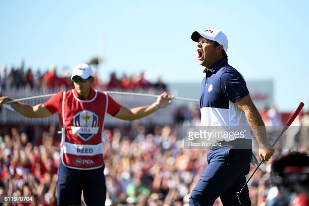 Patrick Reed of the United States reacts on the first green as caddie Kessler Karain looks on during singles matches of the 2016 Ryder Cup at...