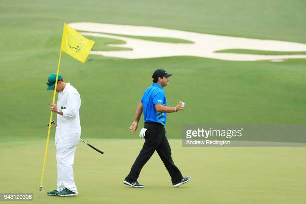 Patrick Reed of the United States reacts to a birdie on the tenth green during the third round of the 2018 Masters Tournament at Augusta National...