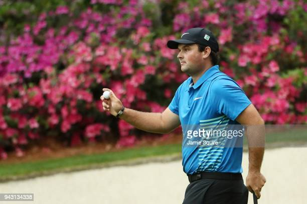 Patrick Reed of the United States reacts to an eagle on the 13th green during the third round of the 2018 Masters Tournament at Augusta National Golf...