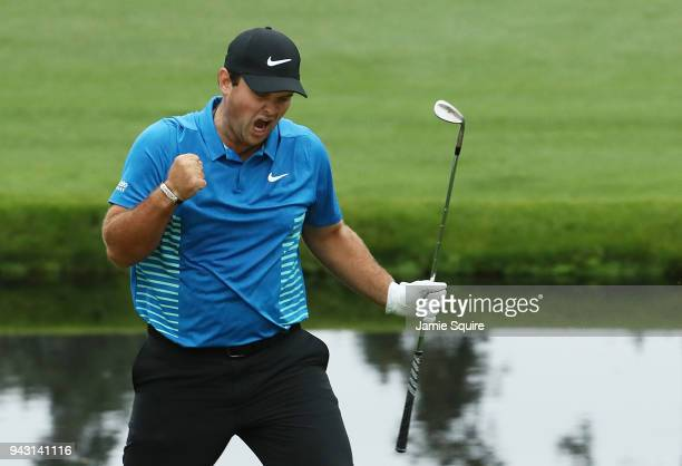 Patrick Reed of the United States reacts to an eagle on the 15th green during the third round of the 2018 Masters Tournament at Augusta National Golf...