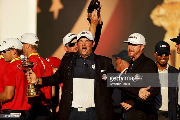 Patrick Reed of the United States reacts while holding the Ryder Cup during the closing ceremony after defeating Europe singles matches of the 2016...