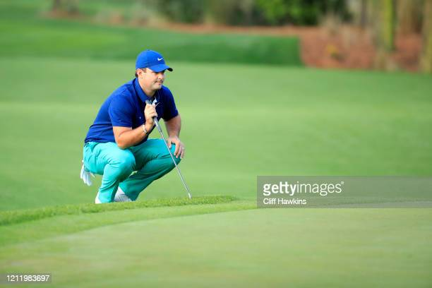 Patrick Reed of the United States reads a putt on the 11th green during the first round of The PLAYERS Championship on The Stadium Course at TPC...