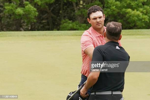 Patrick Reed of the United States shakes hands with Sergio Garcia of Spain after defeating him 21 during the third round of the World Golf...