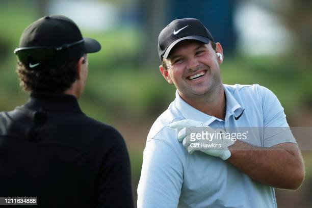 Patrick Reed of the United States talks to his swing coach Kevin Kirk during a practice round prior to The PLAYERS Championship on The Stadium Course...