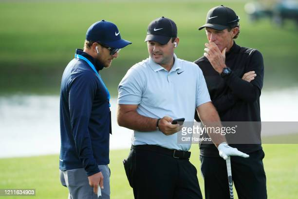 Patrick Reed of the United States talks to his swing coach Kevin Kirk and caddie Kessler Karain during a practice round prior to The PLAYERS...