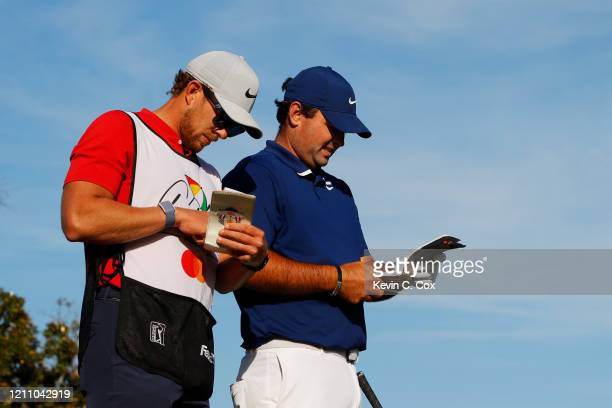 Patrick Reed of the United States talks with his caddie Kessler Karain on the 15th tee during the third round of the Arnold Palmer Invitational...