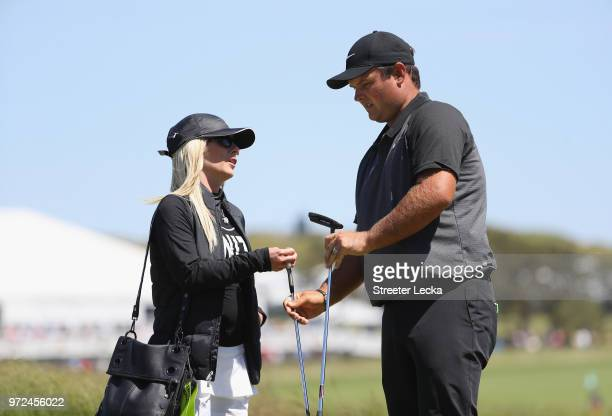 Patrick Reed of the United States talks with his wife Justine Karain during a practice round prior to the 2018 U.S. Open at Shinnecock Hills Golf...