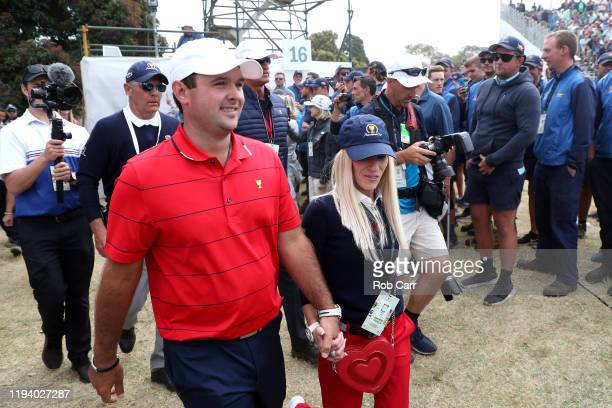 Patrick Reed of the United States team and wife Justine Reed celebrate after they won the Presidents Cup 16-14 on day four of the 2019 Presidents Cup...