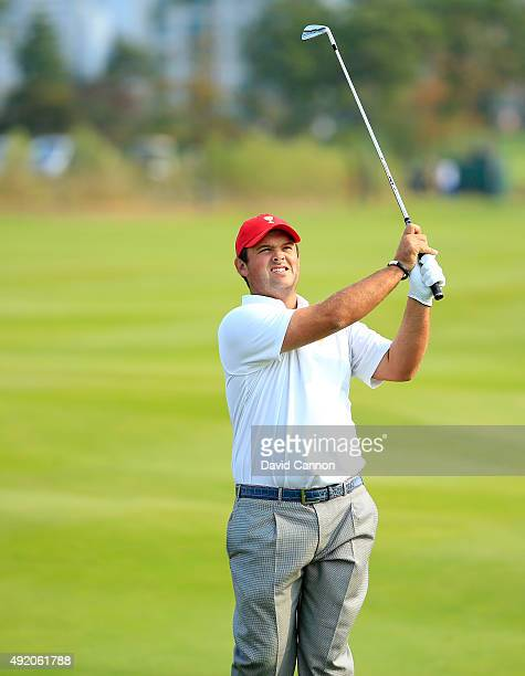 Patrick Reed of the United States team plays his third shot on the seventh hole in his match with Rickie Fowler against Louis Oosthuizen and Branden...