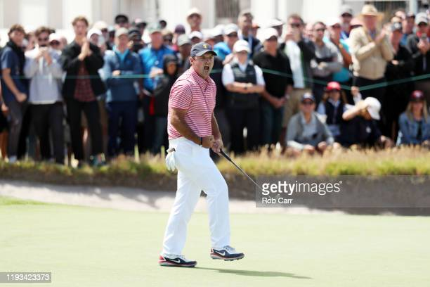Patrick Reed of the United States team reacts on the 16th green during Thursday four-ball matches on day one of the 2019 Presidents Cup at Royal...