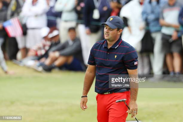 Patrick Reed of the United States team reacts to a missed putt on the 15th green during Saturday four-ball matches on day three of the 2019...