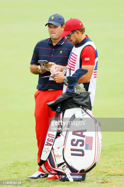 Patrick Reed of the United States team talks with his caddie Kessler Karain during Saturday four-ball matches on day three of the 2019 Presidents Cup...