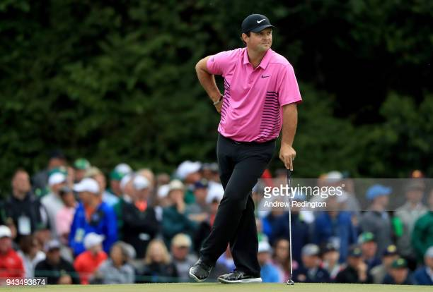 Patrick Reed of the United States waits on the 17th green during the final round of the 2018 Masters Tournament at Augusta National Golf Club on...