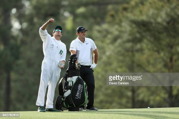 Patrick Reed of the United States waits with caddie Kessler Karain to play his second shot on the 14th hole during the second round of the 2018...