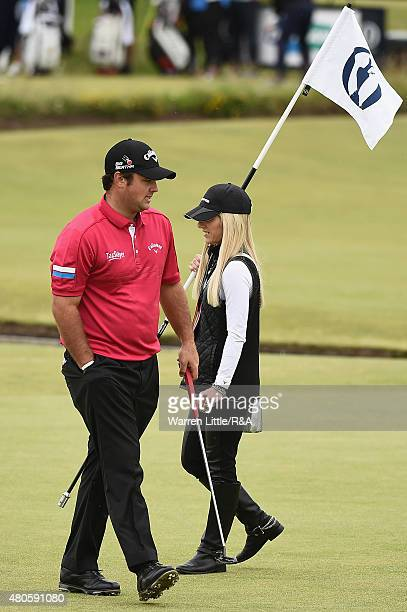 Patrick Reed of the United States walks across a green alongside his wife Justine ahead of the 144th Open Championship at The Old Course on July 13...