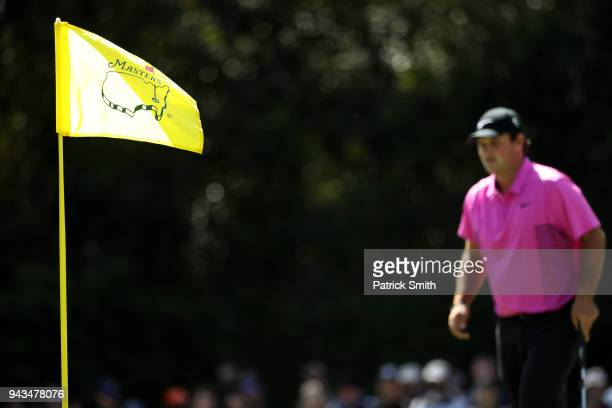 Patrick Reed of the United States walks onto the 7th green as a Masters pin flag is displayed during the final round of the 2018 Masters Tournament...