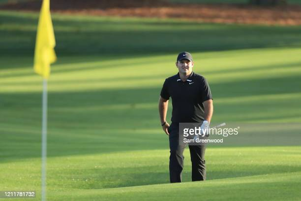 Patrick Reed of the United States walks to the green after playing an approach shot during a practice round prior to The PLAYERS Championship on The...