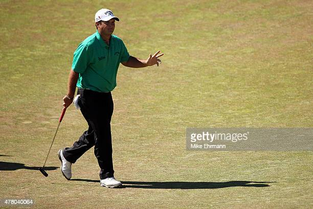 Patrick Reed of the United States waves on the 12th green during the final round of the 115th US Open Championship at Chambers Bay on June 21 2015 in...