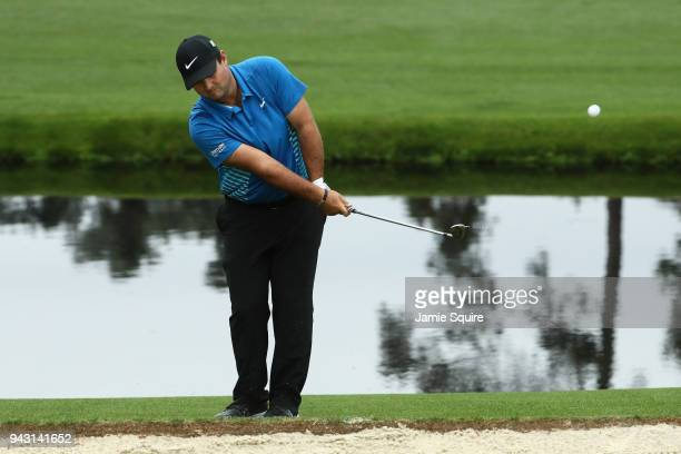 Patrick Reed of the United Stateschips in for an eagle on the 15th green during the third round of the 2018 Masters Tournament at Augusta National...