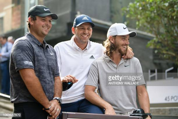 Patrick Reed of the US Sergio Garcia of Spain and Tommy Fleetwood of England pose during a promotional event ahead of the Hong Kong Open golf...