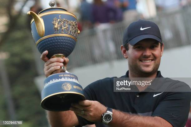 Patrick Reed of the USA holds the cup celebrating winning first place in the PGA World Golf Championship tournament at the Chapultepec Golf Club on...