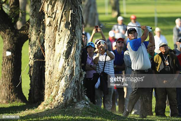 Patrick Reed of the USA plays his second shot into the 15th green during the second round of the USB Hong Kong Open at The Hong Kong Golf Club on...