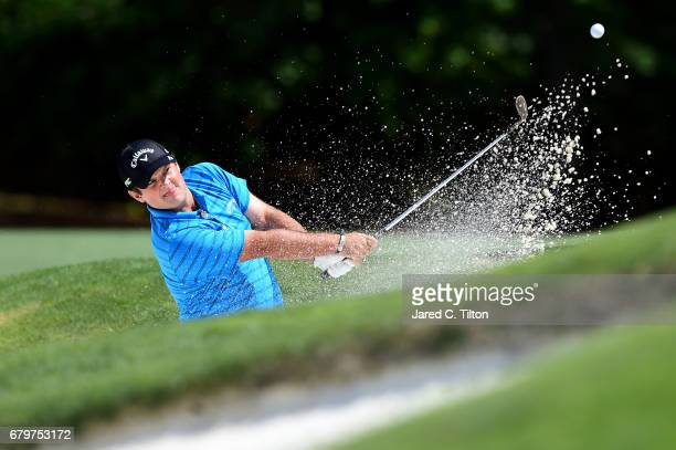 Patrick Reed plays a shot from a bunker on the 11th hole during round three of the Wells Fargo Championship at Eagle Point Golf Club on May 6 2017 in...