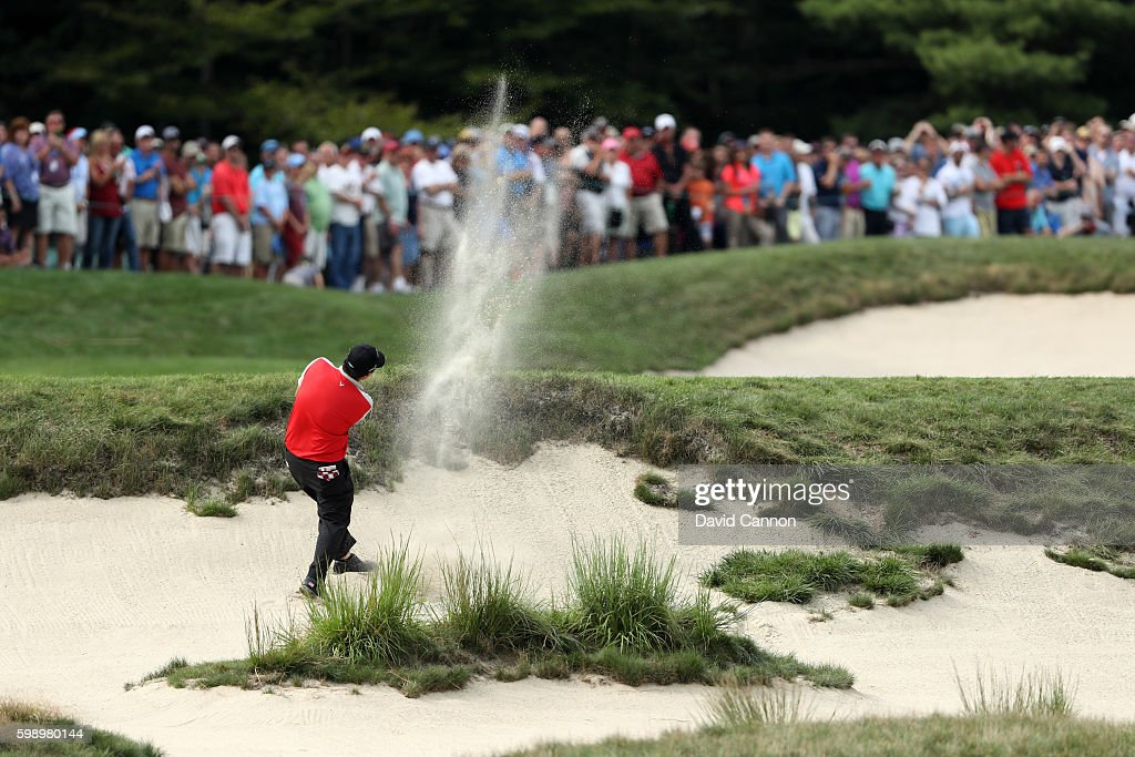 Patrick Reed plays a shot from a bunker on the seventh hole during the second round of the Deutsche Bank Championship at TPC Boston on September 3, 2016 in Norton, Massachusetts.