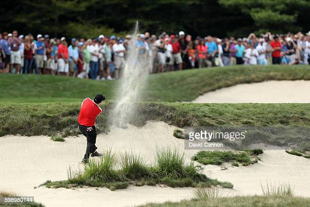 Patrick Reed plays a shot from a bunker on the seventh hole during the second round of the Deutsche Bank Championship at TPC Boston on September 3,...