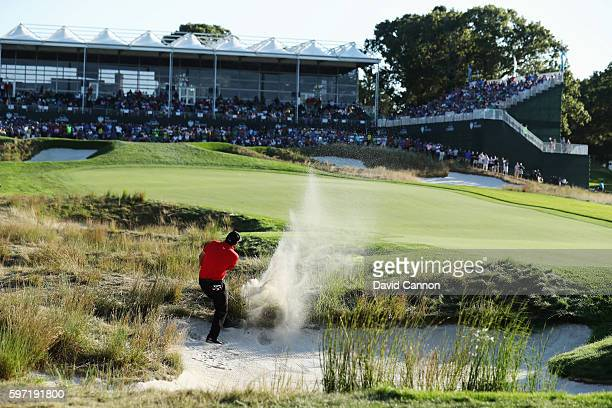Patrick Reed plays a shot from a fairway bunker on the 18th hole during the final round of The Barclays in the PGA Tour FedExCup PlayOffs on the...