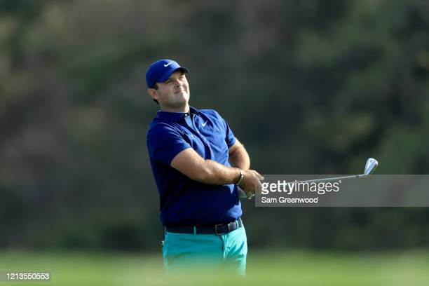Patrick Reed plays a shot on the 14th hole during the first round of The PLAYERS at the TPC Stadium course on March 12 2020 in Ponte Vedra Beach...