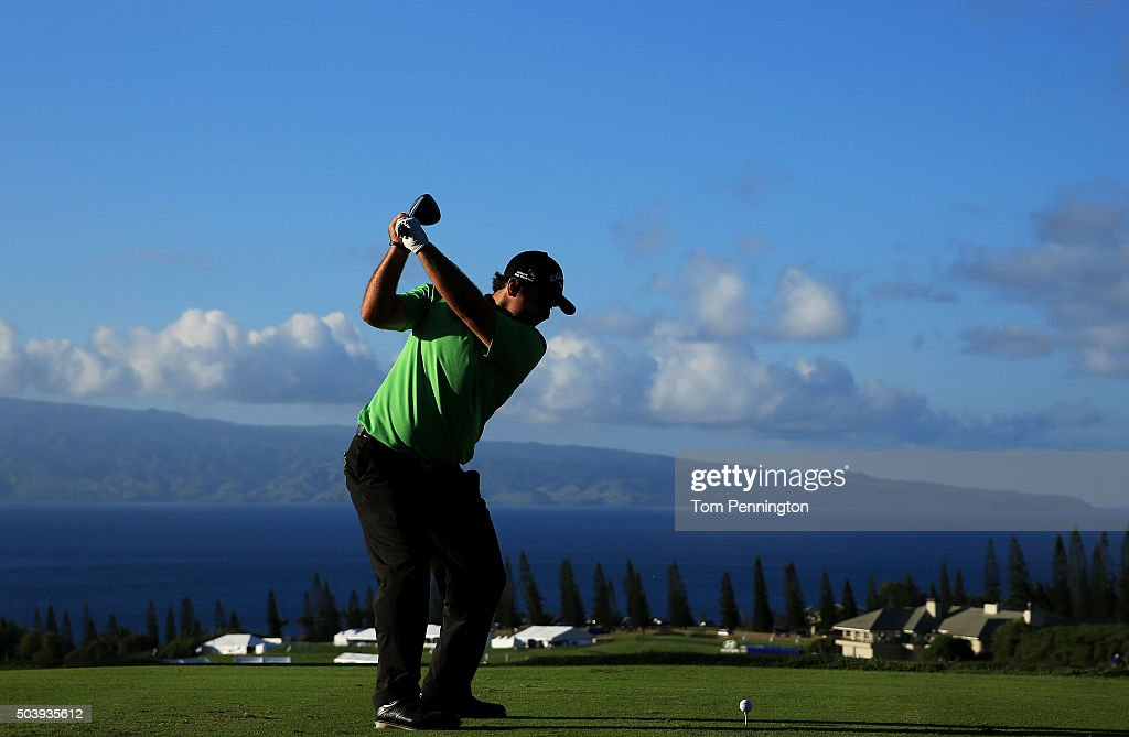 Patrick Reed plays his shot from the 18th tee during round one of the Hyundai Tournament of Champions at the Plantation Course at Kapalua Golf Club on January 7, 2016 in Lahaina, Hawaii.