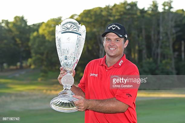 Patrick Reed poses with the tournament trophy after winning The Barclays at Bethpage State Park on August 28 2016 in Farmingdale New York