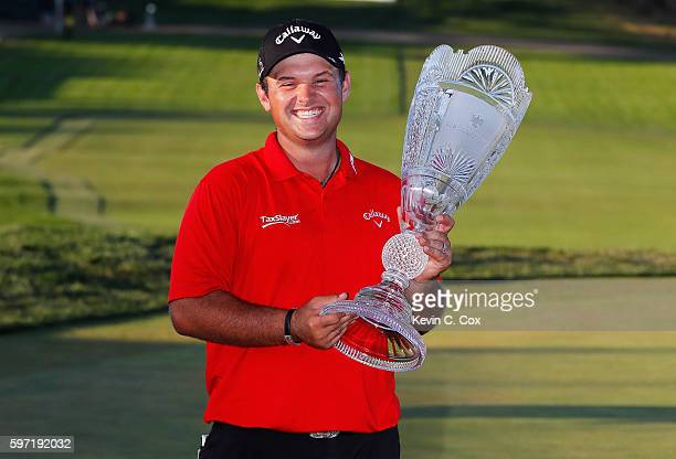 Patrick Reed poses with the trophy after winning The Barclays in the PGA Tour FedExCup PlayOffs on the Black Course at Bethpage State Park on August...