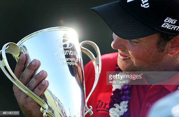 Patrick Reed poses with the winner's trophy after winning during the final round of the Hyundai Tournament of Champions at Plantation Course at...