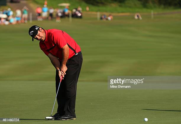 Patrick Reed putts for birdie during a playoff on the 18th hole to win the final round of the Hyundai Tournament of Champions at Plantation Course at...