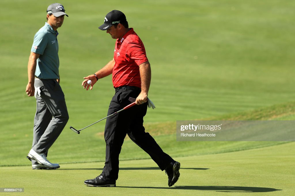 Patrick Reed (R) reacts after losing the 5th hole of his match against Kevin Kisner during round two of the World Golf Championships-Dell Technologies Match Play at the Austin Country Club on March 23, 2017 in Austin, Texas.
