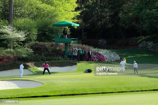 Patrick Reed reacts to his birdie putt on Hole No 12 during the final round of the Masters at Augusta National Golf Club Sunday April 8 2018