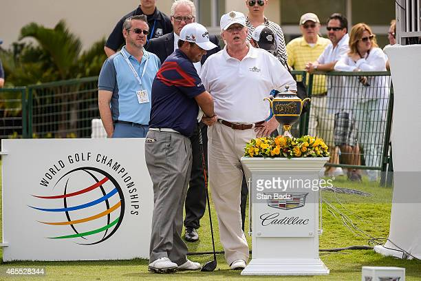 Patrick Reed shakes hands with Donald Trump before teeing off on the first hole during the third round of the World Golf ChampionshipsCadillac...