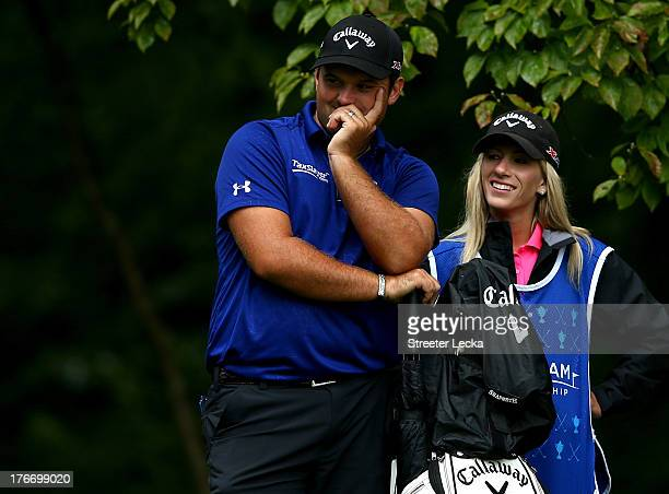 Patrick Reed stands with his caddie and wife Justine as he waits to hit on the 2nd hole during the third round of the Wyndham Championship at...