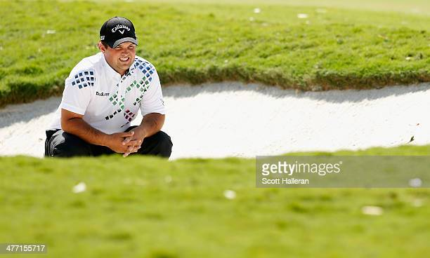Patrick Reed waits to play a bunker shot on the first hole during the second round of the World Golf Championships-Cadillac Championship at Trump...