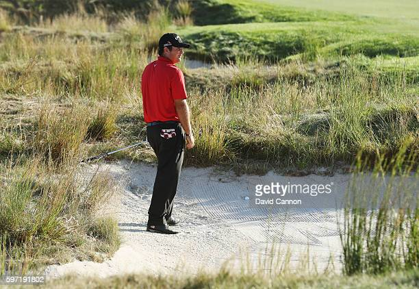 Patrick Reed waits to play a shot from a fairway bunker on the 18th hole during the final round of The Barclays in the PGA Tour FedExCup PlayOffs on...