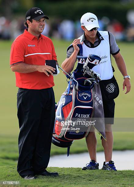 Patrick Reed waits with his caddie Kessler Karain during the final round of the World Golf ChampionshipsCadillac Championship at Trump National Doral...