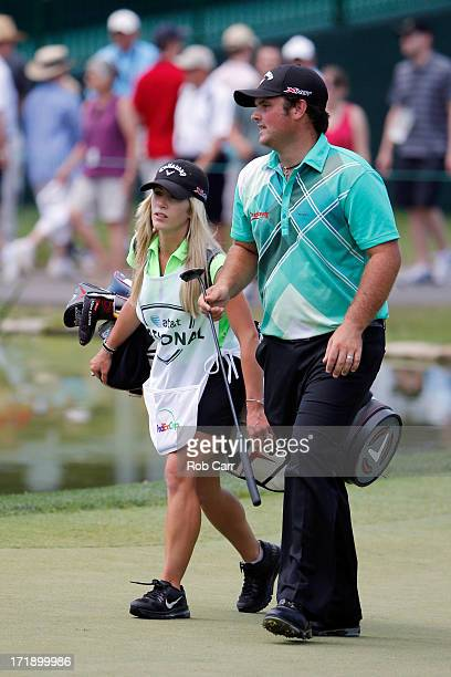 Patrick Reed walks off the 11th green with his wife/caddie Justine during Round Three of the ATT National at Congressional Country Club of the on...