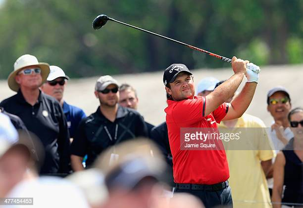 Patrick Reed watches his tee shot on the second hole during the final round of the World Golf ChampionshipsCadillac Championship at Trump National...
